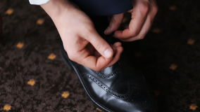 Man tying shoelaces stock footage