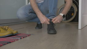 MAN TYING SHOELACES IN SHOES stock footage