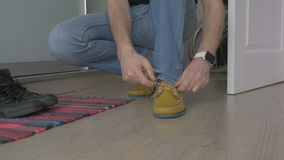 MAN TYING SHOELACES IN SHOES stock video