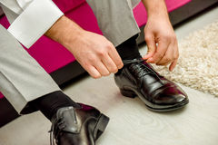 Man tying shoelaces shoes Stock Photography