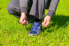 Man tying shoelaces from sneaker Stock Photography