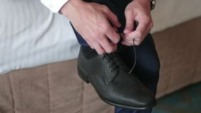 Man Tying Shoes. Slow motion of a man tying his shoes in preparing stock video footage