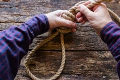 Man tying a slipknot Royalty Free Stock Photos
