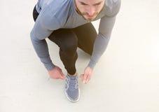 Man tying sport shoe shoelace. Portrait of a man tying sport shoe shoelace Royalty Free Stock Photos
