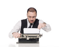 Man with a typewriter. Man writing on a vintage typewriter Stock Photography