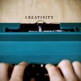 Man typewriting the word creativity Stock Images