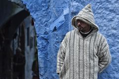 A man in typical moroccan clothing, Chefchaouen Morocco. A man in typical moroccan clothing, in a street in the blue Medina of Chefchaouen Stock Photos