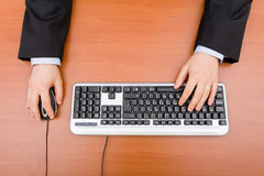 Man typing in the computer. Keyboard and using a mouse stock image