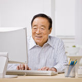 Man typing on computer Royalty Free Stock Image