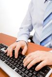 Man typing in the computer keyboard Stock Photos