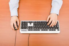 Man typing in the computer keyboard Stock Photography