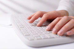 Man typing on a computer keyboard Royalty Free Stock Photos