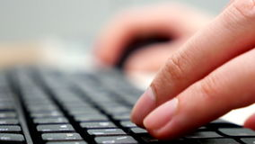 Man typing on the computer keyboard stock footage