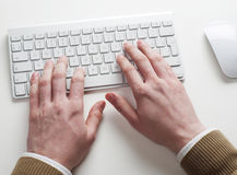 Man typing on computer keyboard Stock Photo