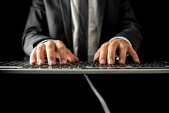 Man typing on a computer keyboard Royalty Free Stock Photo