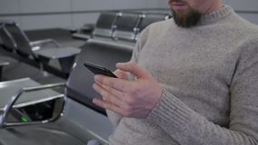 Man is typing on display of mobile phone stock footage