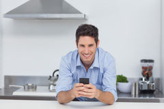 Man typing on his smartphone Stock Image