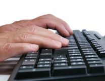 Man Typing at Keyboard Stock Photo