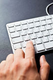 Man typing on keyboard Stock Photography