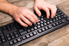 Man is typing on  keyboard Royalty Free Stock Images