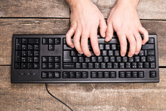 Man is typing on  keyboard Royalty Free Stock Photography