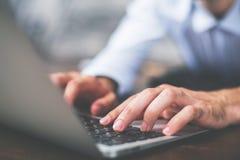 Man typing on keyboard side Stock Photos