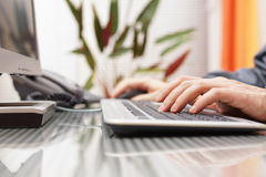 Man is typing on keyboard and using mouse Stock Photography