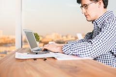 Man typing on keypad side stock photo