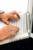 Man typing on a laptop. Man hands typing on a laptop Royalty Free Stock Photos