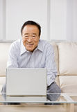 Man typing on laptop Stock Images