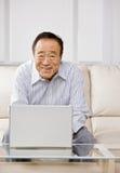 Man typing on laptop Stock Images