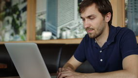 Man typing at a laptop stock footage