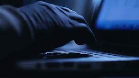 Man typing on laptop computer, blue toned. Man typing on laptop computer, blue stock video footage