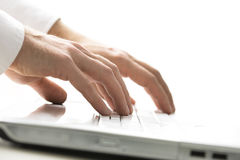 Man typing on a laptop computer Royalty Free Stock Image