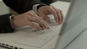 Man typing on laptop computer keyboard stock footage
