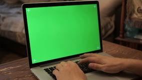 A man typing on a laptop. Green screen,. Green screen for your custom screen content stock video