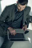 Man typing on laptop stock photography