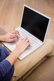 Man typing on a laptop Royalty Free Stock Image