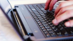 Man typing on laptop keyboard. Human hands typing on a black laptop keyboard. White background stock video
