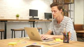 Man Typing on Laptop Keyboard in Modern Loft Office stock video