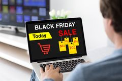 Man typing on laptop keyboard with sale black friday screen Royalty Free Stock Photo