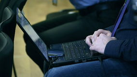 Man typing on laptop. In meeting stock video footage
