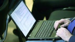 Man typing on laptop. In meeting stock footage