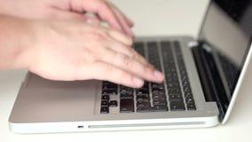 Man typing on  laptop. Man typing on silver laptop stock video footage