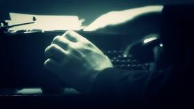Man typing on a manual typewriter. Vintage 40's style