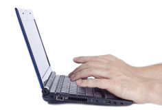 Man Typing on a Mini Netbook Royalty Free Stock Photography