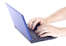 Man Typing on a Mini Netbook Royalty Free Stock Images