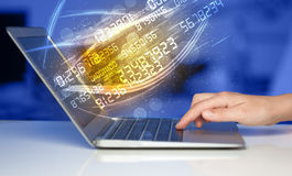Man typing on modern notebook with number technology data coming Royalty Free Stock Images