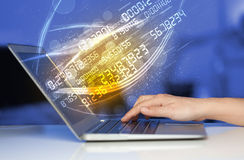Man typing on modern notebook with number technology data coming Royalty Free Stock Image