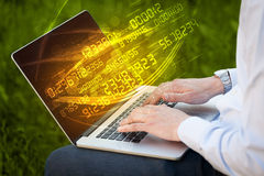 Man typing on modern notebook with number technology data coming Royalty Free Stock Photo